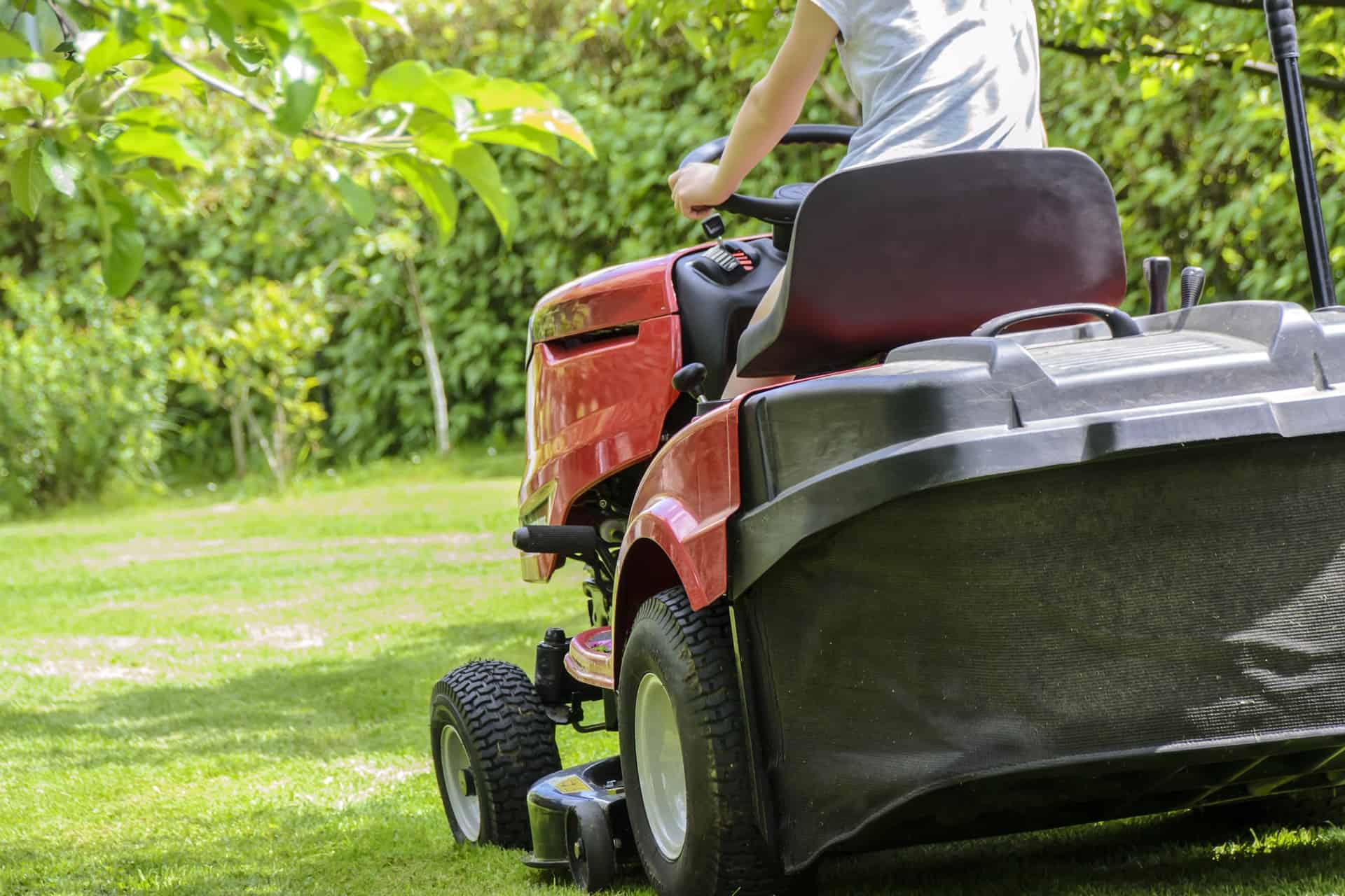 woman on riding lawn mower